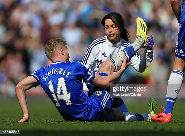 Andre Schurrle of Chelsea receives treatment from Chelsea physio Eva Carneiro during the Barclays Premier League match between Liverpool and Chelsea...