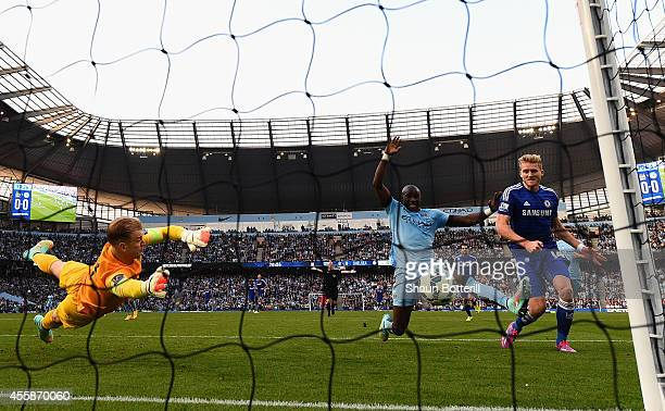 Andre Schurrle of Chelsea scores the first goal past Joe Hart of MAnchester City during the Barclays Premier League match between Manchester City and...