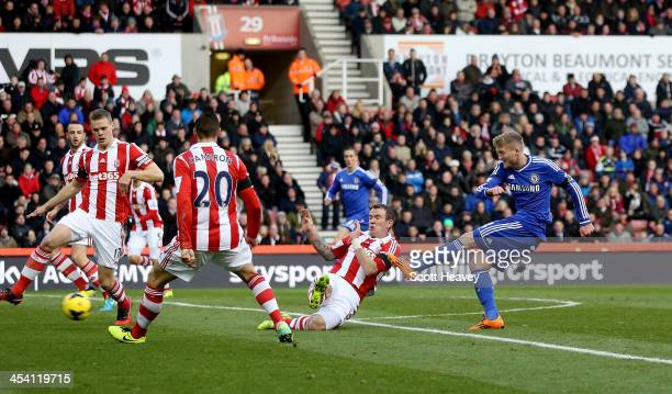 Andre Schurrle of Chelsea scores their first goal during the Barclays Premier League match between Stoke City and Chelsea at Britannia Stadium on...