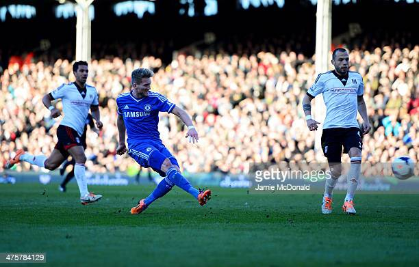 Andre Schurrle of Chelsea scores their third goal and completes his hat trick during the Barclays Premier League match between Fulham and Chelsea at...