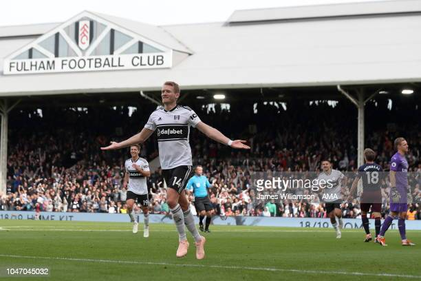 Andre Schurrle of Fulham celebrates after scoring a goal to make it 11 during the Premier League match between Fulham FC and Arsenal FC at Craven...