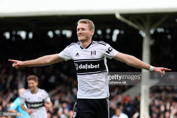 Andre Schurrle of Fulham celebrates after scoring his team's first goal during the Premier League match between Fulham FC and Arsenal FC at Craven...