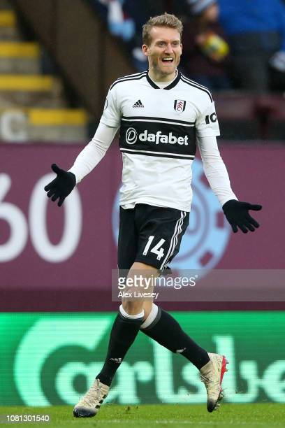 Andre Schurrle of Fulham celebrates after scoring his team's first goal during the Premier League match between Burnley FC and Fulham FC at Turf Moor...