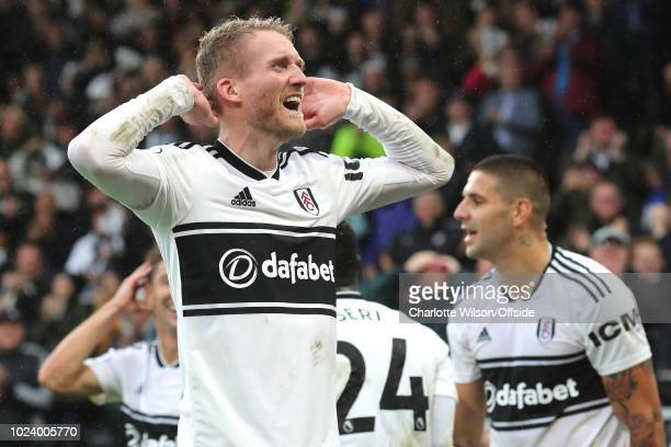Andre Schurrle of Fulham celebrates scoring their 4th goal during the Premier League match between Fulham FC and Burnley FC at Craven Cottage on...