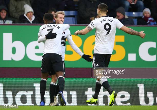 Andre Schurrle of Fulham celebrates with teammates Aleksandar Mitrovic and Ryan Sessegnon after scoring his team's first goal during the Premier...