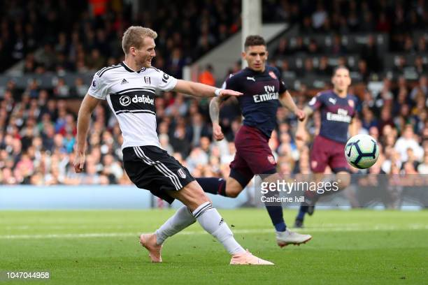 Andre Schurrle of Fulham scores his team's first goal during the Premier League match between Fulham FC and Arsenal FC at Craven Cottage on October 7...