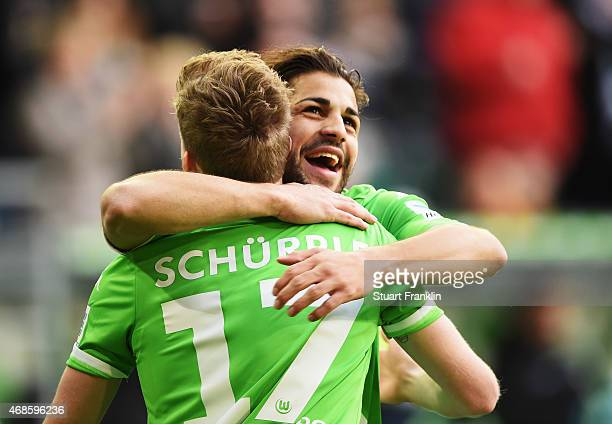 Andre Schurrle of Wolfsburg celebrates scoring his goal with Ricardo Rodriguez during the Bundesliga match between VfL Wolfsburg and VfB Stuttgart at...