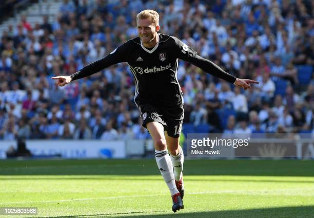 Andre Shurrle of Fulham celebrates after scoring his team's first goal during the Premier League match between Brighton Hove Albion and Fulham FC at...