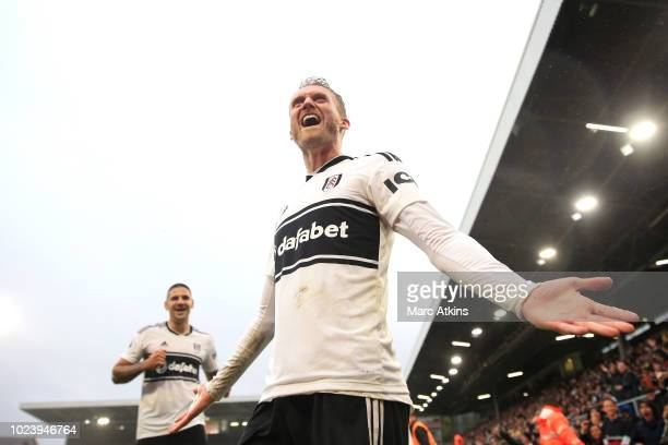 Andre Shurrle of Fulham celebrates after scoring his team's fourth goal during the Premier League match between Fulham FC and Burnley FC at Craven...