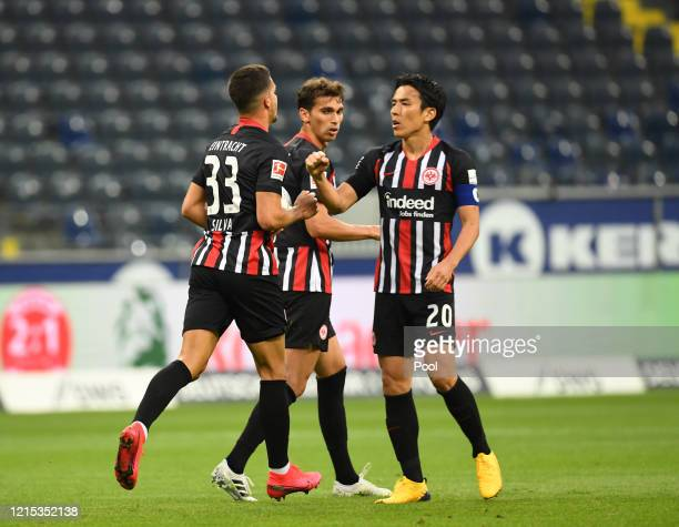 Andre Silva celebrates with his teammates from Frankfurt, Lucas Torro and Makoto Hasebeafter he scores his teams first goal during the Bundesliga...
