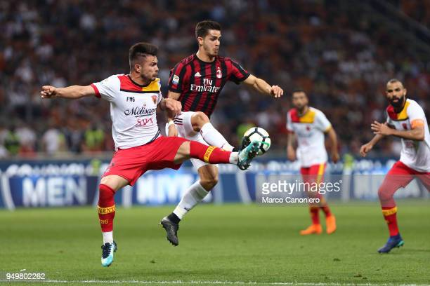 Andre Silva of Ac Milan and AlinDorinel Tosca of Benevento Calcio in action during the Serie A football match between AC Milan and Benevento Calcio...