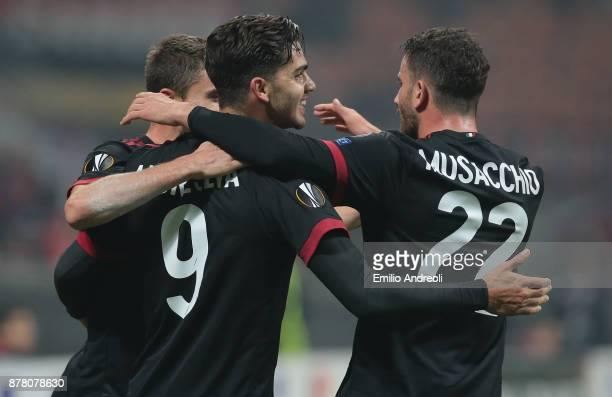 Andre Silva of AC Milan celebrates his first goal with his teammate Mateo Pablo Musacchio during the UEFA Europa League group D match between AC...