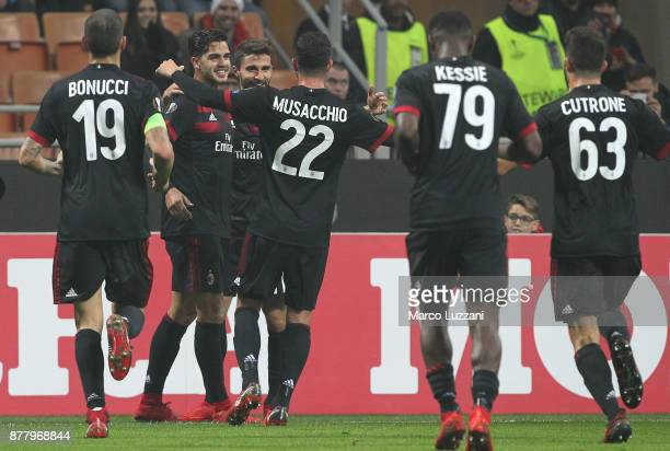 Andre Silva of AC Milan celebrates his goal with his teammate during the UEFA Europa League group D match between AC Milan and Austria Wien at Stadio...