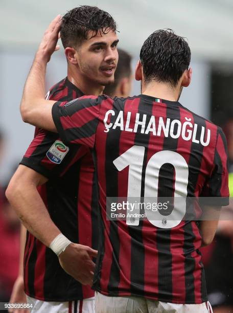 Andre Silva of AC Milan celebrates his goal with his teammate Hakan Calhanoglu during the serie A match between AC Milan and AC Chievo Verona at...