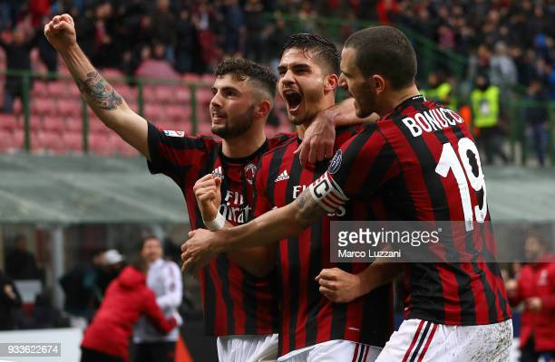 Andre Silva of AC Milan celebrates his goal with his teammates Patrick Cutrone and Leonardo Bonucci during the serie A match between AC Milan and AC...