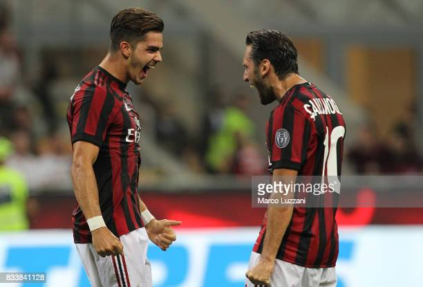 Andre Silva of AC Milan celebrates his second goal with his teammate Hakan Calhanoglu during the UEFA Europa League Qualifying PlayOffs round first...
