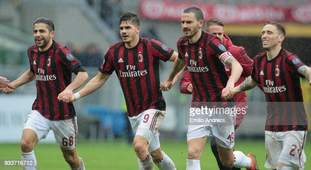 Andre Silva of AC Milan celebrates the victory with his teammate Ricardo Rodriguez Leonardo Bonucci and Lucas Biglia at the end of the serie A match...