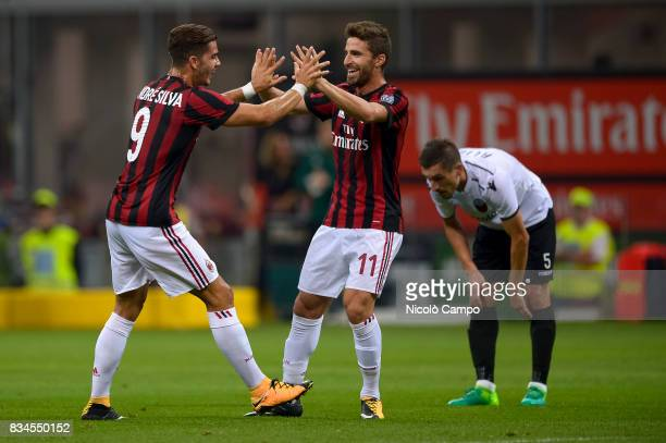 Andre Silva of AC Milan celebrates with Fabio Borini after scoring a goal during the UEFA Europa League Qualifying PlayOffs Round First Leg match...
