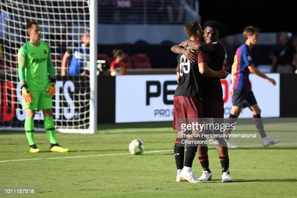 Andre Silva of AC Milan celebrates with Franck Kessie after his goal in stoppage time against the FC Barcelona during their International Champions...