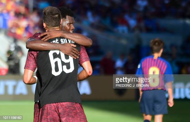Andre Silva of AC Milan celebrates with Franck Kessie who assisted on Silva's injury time goal during the International Champions Cup friendly...