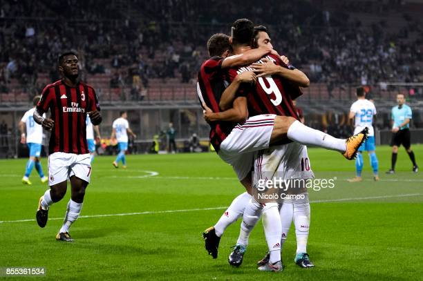 Andre Silva of AC Milan celebrates with his team mates after scoring a goal during the UEFA Europa League Group D match between AC Milan and HNK...