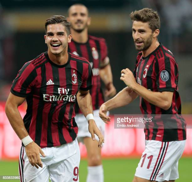 Andre Silva of AC Milan celebrates with his teammate Fabio Borini after scoring the opening goal during the UEFA Europa League Qualifying PlayOffs...