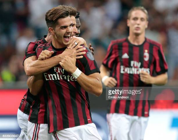 Andre Silva of AC Milan celebrates with his teammate Fabio Borini after scoring his second goal during the UEFA Europa League Qualifying PlayOffs...