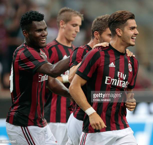 Andre Silva of AC Milan celebrates with his teammate Franck Kessie after scoring his second goal during the UEFA Europa League Qualifying PlayOffs...