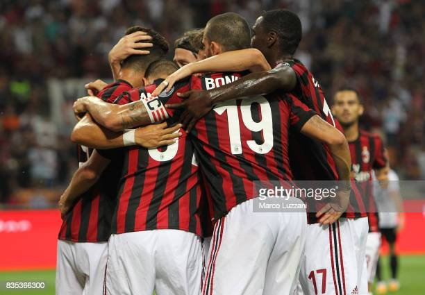 Andre Silva of AC Milan celebrates with his teammates after scoring the opening goal during the UEFA Europa League Qualifying PlayOffs round first...
