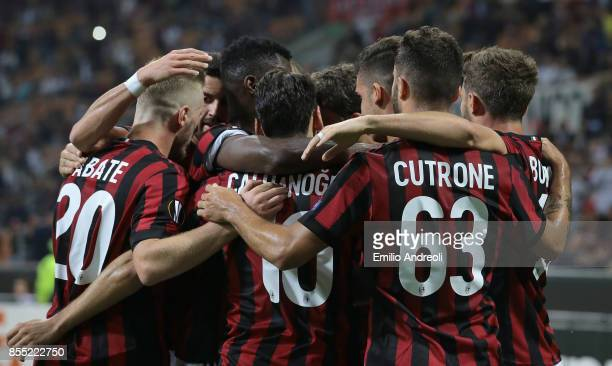 Andre Silva of AC Milan celebrates with his teammates after scoring the opening goal during the UEFA Europa League group D match between AC Milan and...