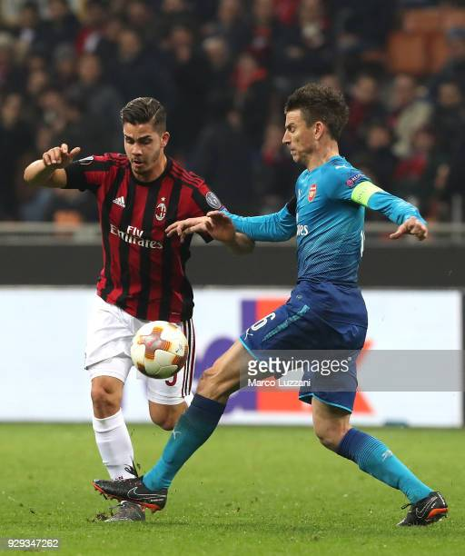 Andre Silva of AC Milan competes for the ball with Laurent Koscielny of Arsenal during UEFA Europa League Round of 16 match between AC Milan and...