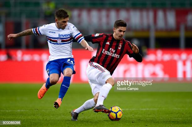 Andre Silva of AC Milan competes for the ball with Lucas Torreira of UC Sampdoria during the Serie A football match between AC Milan and UC Sampdoria...