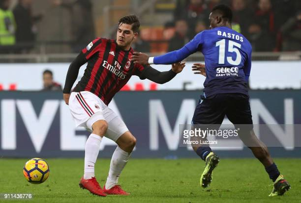Andre Silva of AC Milan competes for the ball with Quissanga Bastos of SS Lazio during the serie A match between AC Milan and SS Lazio at Stadio...