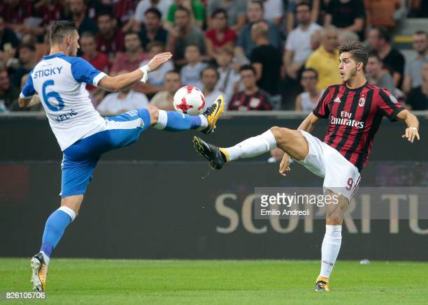 Andre Silva of AC Milan competes for the ball with Renato Kelic of CS U Craiova during the UEFA Europa League Third Qualifying Round Second Leg match...
