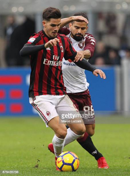 Andre Silva of AC Milan competes for the ball with Tomas Rincon of Torino FC during the Serie A match between AC Milan and Torino FC at Stadio...