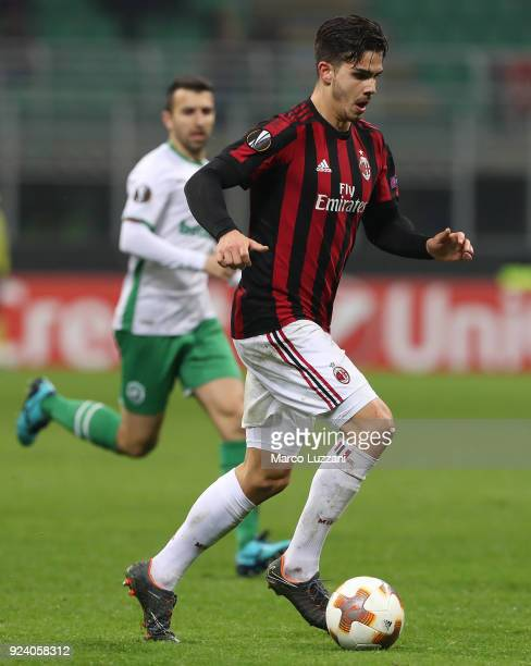 Andre Silva of AC Milan drives the ball during UEFA Europa League Round of 32 match between AC Milan and Ludogorets Razgrad at the San Siro on...