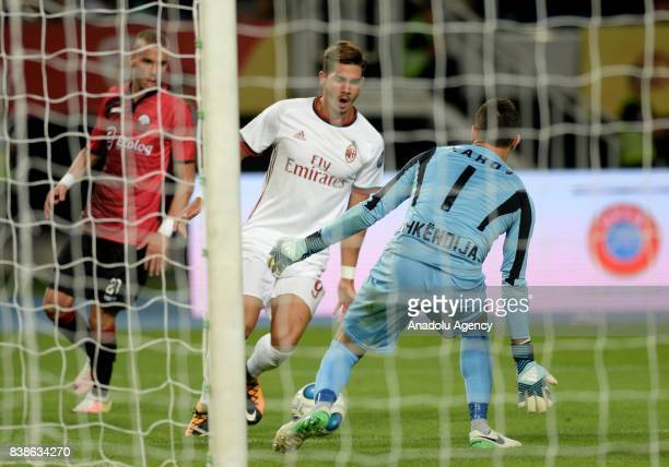 Andre Silva of AC Milan in action against Zahov of Shkendija 79 during the UEFA Europa League playoff soccer match between AC Milan and Shkendija 79...