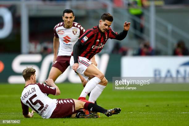 Andre Silva of AC Milan is tackled by Cristian Ansaldi of Torino FC during the Serie A football match between AC Milan and Torino FC The match ended...