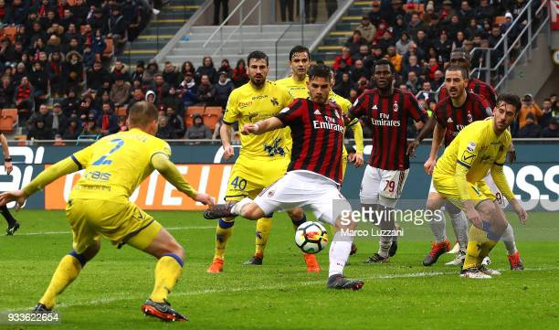 Andre Silva of AC Milan scores his goal during the serie A match between AC Milan and AC Chievo Verona at Stadio Giuseppe Meazza on March 18 2018 in...