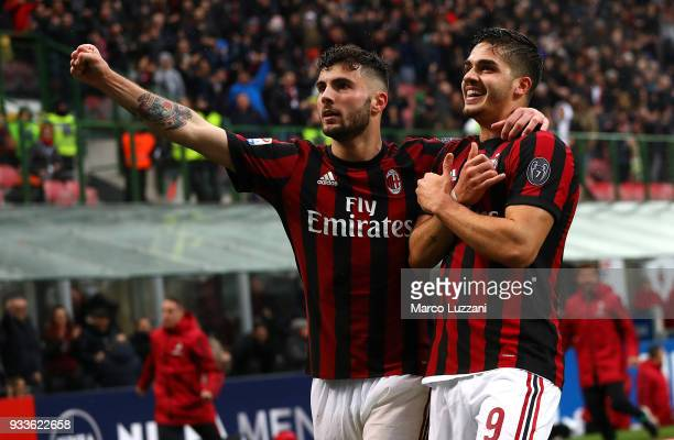 Andre Silva of AC Milancelebrates his goal with his teammate Patrick Cutrone during the serie A match between AC Milan and AC Chievo Verona at Stadio...