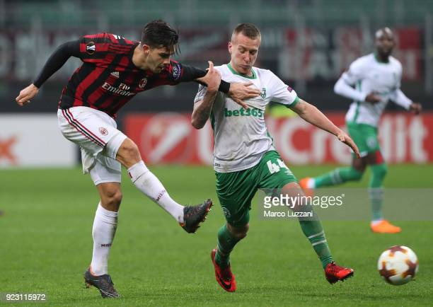 Andre Silva of AC Milanis challenged by Jacek Goralski of Ludogorets Razgrad during UEFA Europa League Round of 32 match between AC Milan and...