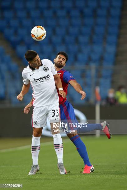 Andre Silva of Eintracht Frankfurt and Eray Ervin Coemert of FC Basel 1893 battle for the ball during the UEFA Europa League round of 16 second leg...