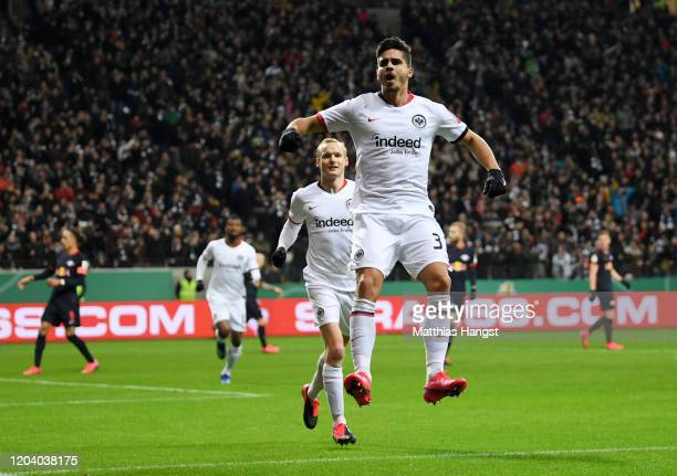 Andre Silva of Eintracht Frankfurt celebrates after scoring his team's first goal during the DFB Cup round of sixteen match between Eintracht...