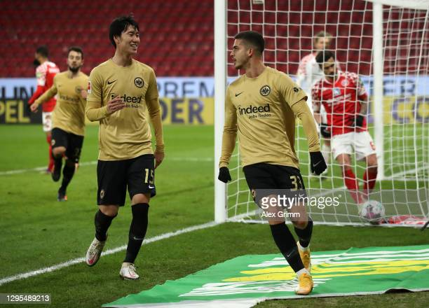 Andre Silva of Eintracht Frankfurt celebrates with Daichi Kamada after scoring their team's second goal during the Bundesliga match between 1. FSV...