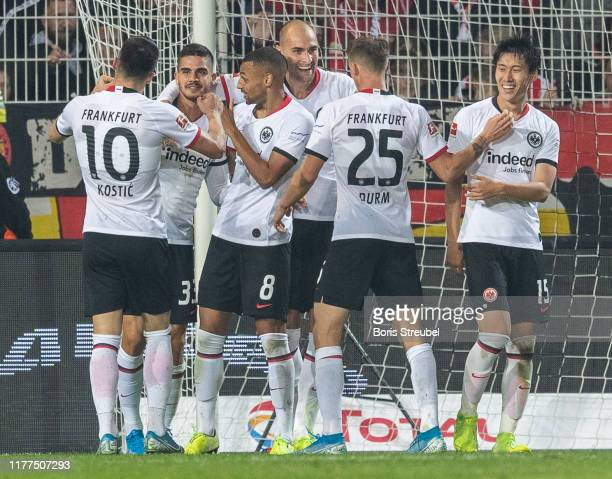 Andre Silva of Eintracht Frankfurt celebrates with team mates after scoring his team's second goal during the Bundesliga match between 1. FC Union...