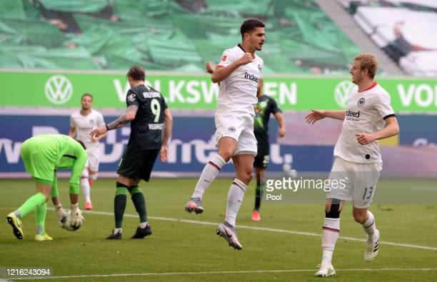 Andre Silva of Eintracht Frankfurt celebrates with teammate Martin Hinteregger after scoring his team's first goal from the penalty spot during the...