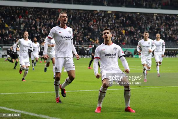 Andre Silva of Eintracht Frankfurt celebrates with teammate Stefan Ilsanker after scoring his sides first goal during the DFB Cup quarterfinal match...