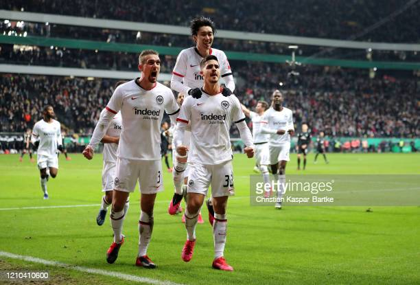 Andre Silva of Eintracht Frankfurt celebrates with teammates after scoring his sides first goal during the DFB Cup quarterfinal match between...