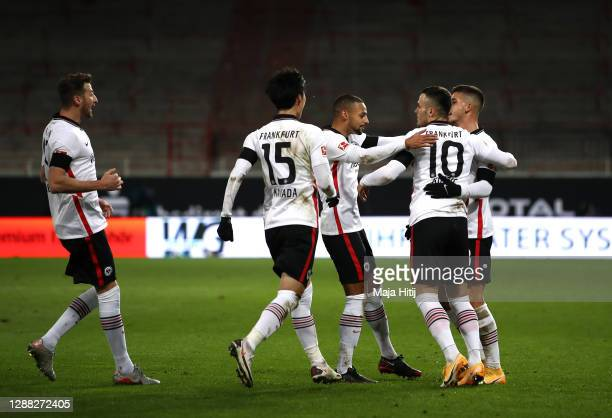 Andre Silva of Eintracht Frankfurt celebrates with teammates after scoring his team's second goal during the Bundesliga match between 1. FC Union...