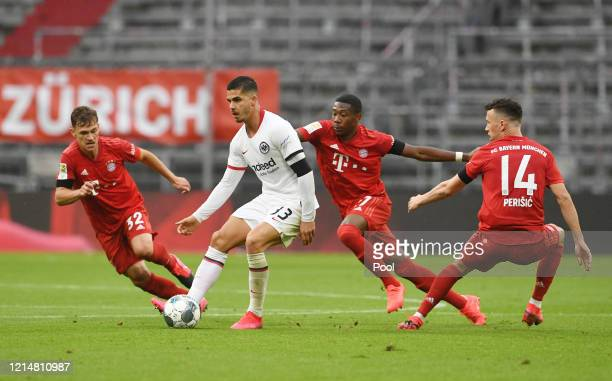 Andre Silva of Eintracht Frankfurt is challenged by Joshua Kimmich Ivan Perisic and David Alaba of FC Bayern Muenchen during the Bundesliga match...
